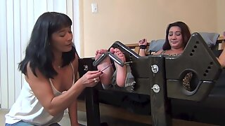 mom tickles daughter-in-law two