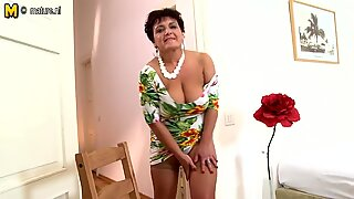 Big breasted housewife playing with her toy